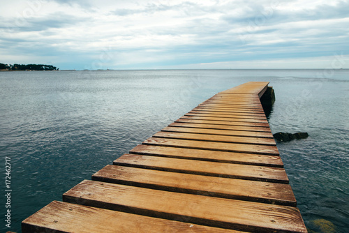Old wooden Bridge In The Sea