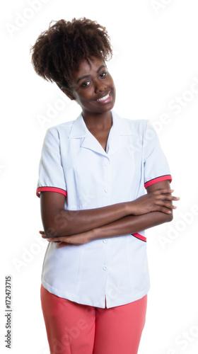 Staande foto Apotheek Lachende afrikanische Drogerieverkäuferin