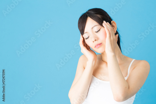 attractive asian woman beauty image isolated on blue background Poster