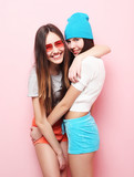 happy smiling pretty teenage girls or friends hugging over pink  - 172480353