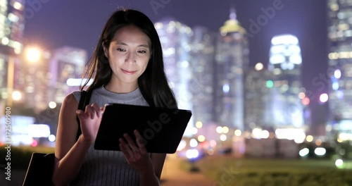Sticker Woman using tablet computer at night