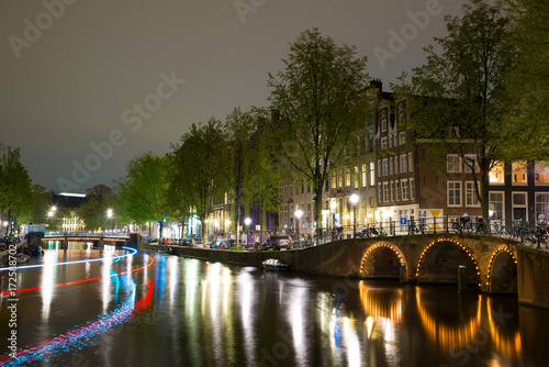 Deurstickers Amsterdam Night view of Amsterdam cityscape with canal, bridge and houses in the evening