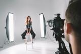 photographer and model in studio - 172592336