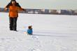 Boy and dog walking