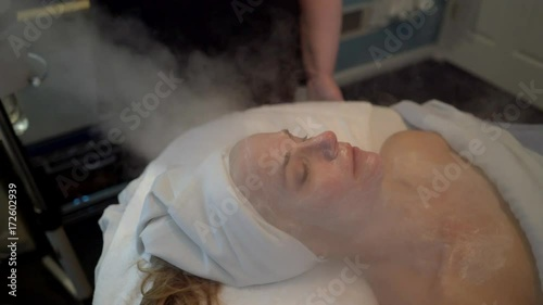 Massage receives a steam treatment on her face during her facial. Steadicam shot.