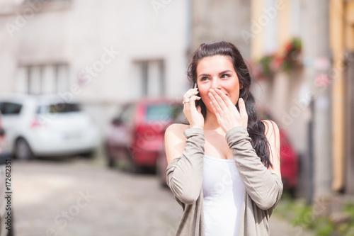 Sticker Cute girl using cellphone on the street.