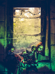 Creepy dolls by the window