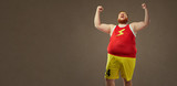 A fat man in sports clothes screams happy at the victory. - 172624198