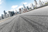 empty asphalt road with cityscape of modern city - 172646778