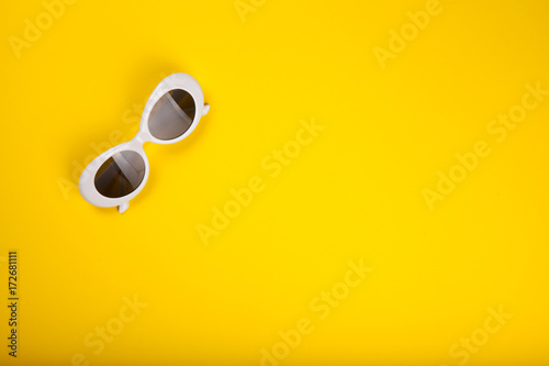 Stylish sunglasses on yellow background - 172681111