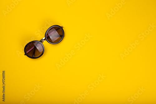 Stylish sunglasses on yellow background - 172681116
