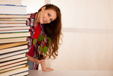 attractive young botany student with seedlnng and books - 172686342