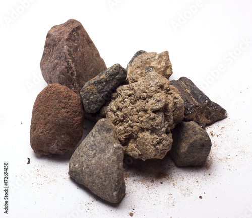 Foto op Canvas Stenen in het Zand stones with sand on white background/stones to sand/isolated objects