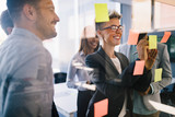 Picture of designers sticking notes in office - 172695568