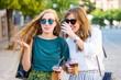 Happy girls walking around the city - 172711732