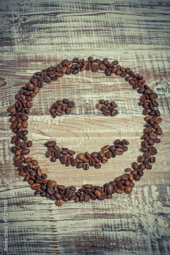 Papiers peints Café en grains Smile from the coffee beans on the Provence-style table