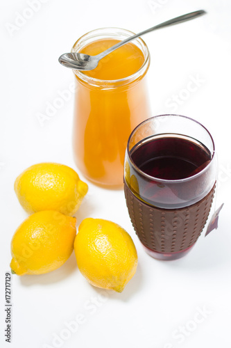 Tea with lemon and honey on the white background Poster