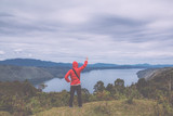 man standing on hill looking at the lake toba - 172723953