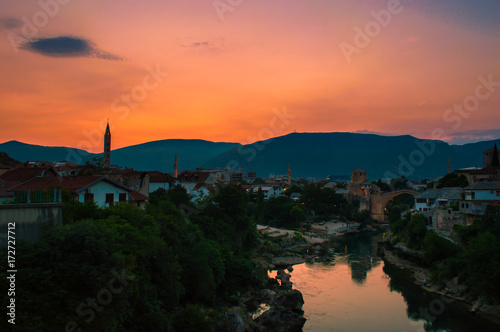 In de dag Koraal Amazing sunset overlooking the beautiful Old Bridge in Mostar, Bosnia and Herzegovina