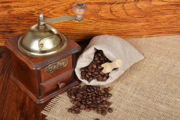 Old retro, manual grinder for grinding coffee beans with empty space for text