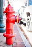 Fire hydrant on sidewalk shallow depth of field
