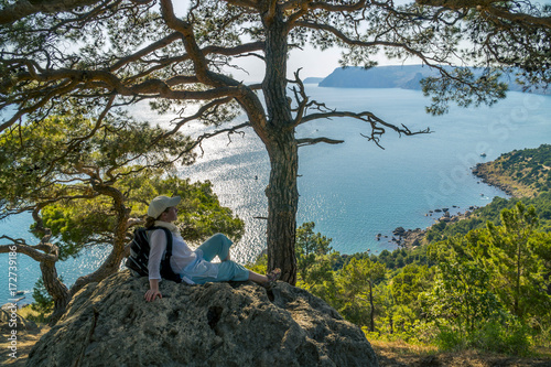Staande foto Grijze traf. Woman Tourist sitting in Crimean Mountains near Sea