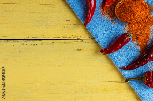Papiers peints Hot chili Peppers Red pepper fresh, dry and ground, on a wooden yellow background, the top view.