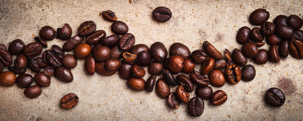 Whole Coffee beans on textured rusty background. Flat lay © tenkende