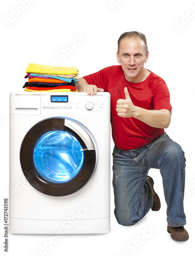 happy man shows a thumb near new washing machine.. Poster