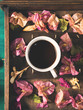 Cups of espresso coffee and flowers on dark green winter fall background