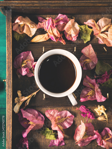 Cups of espresso coffee and flowers on dark green winter fall background Poster