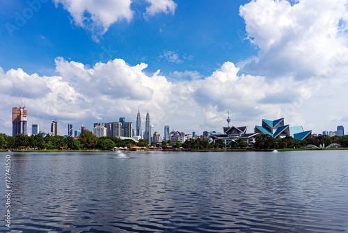 Obraz na plátne Sunny with blue sky and clouds over Kuala Lumpur Skyline seen from Taman Tasik Titiwangsa in Malaysia