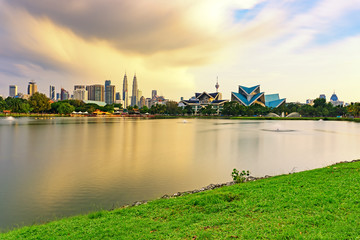 Dramatic storm sunset over Kuala Lumpur skyline, capital city of Malaysia as seen from Taman Tasik Titiwangsa.