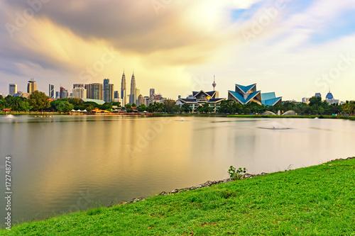 Dramatic storm sunset over Kuala Lumpur skyline, capital city of Malaysia as seen from Taman Tasik Titiwangsa Poster