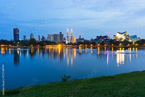 Plagát Blue hour view of Kuala Lumpur skyline, capital city of Malaysia as seen from Taman Tasik Titiwangsa