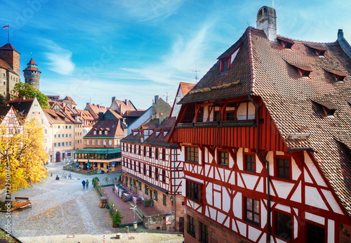 Leinwanddruck Bild Old town of Nuremberg at sunny fall day, Germany, retro toned