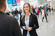 canvas print picture - young beautiful businesswoman at a trade fair