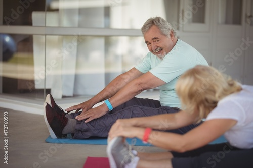 Senior couple performing stretching exercise - 172760593