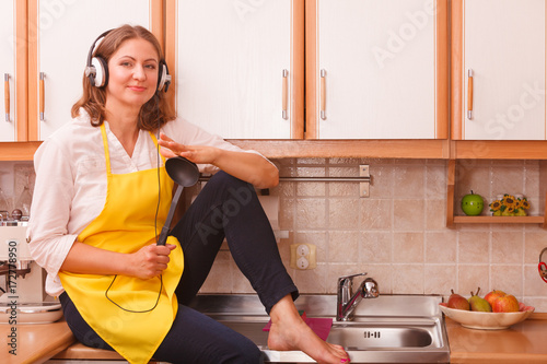 Happy housewife at home