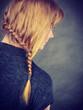 Woman with blonde hair and braid hairdo
