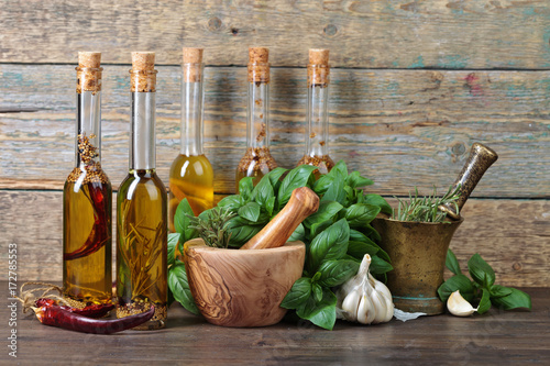 Olive oil with different spices . - 172785553