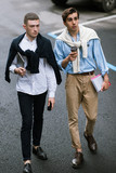 Fashionable pedestrians on street. Stylish men, modern youth lifestyle, communication concept - 172786756