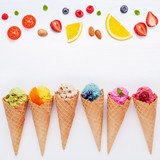 Various of ice cream flavor in cones blueberry ,strawberry ,pistachio ,almond ,orange and cherry setup on white wooden background . Summer and Sweet menu concept. - 172793130