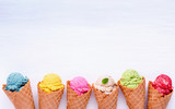 Various of ice cream flavor in cones blueberry ,strawberry ,pistachio ,almond ,orange and cherry setup on white wooden background . Summer and Sweet menu concept. - 172793167