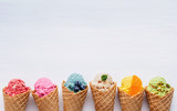 Various of ice cream flavor in cones blueberry ,strawberry ,pistachio ,almond ,orange and cherry setup on white wooden background . Summer and Sweet menu concept. - 172793336
