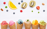 Various of ice cream flavor in cones blueberry ,strawberry ,pistachio ,almond ,orange and cherry setup on white wooden background . Summer and Sweet menu concept. - 172793366