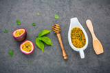 Fresh passion fruits set up on dark stone background. Passion fruits and juice with pepper mint leaves. Healthy food background concept. - 172793994