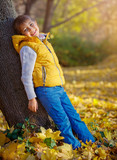 Beautiful young girl in the autumn park