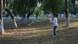 Cute little girl playing with large soap bubbles in a park - 172815309