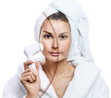 Woman cleansing skin by mechanical brush. - 172823775